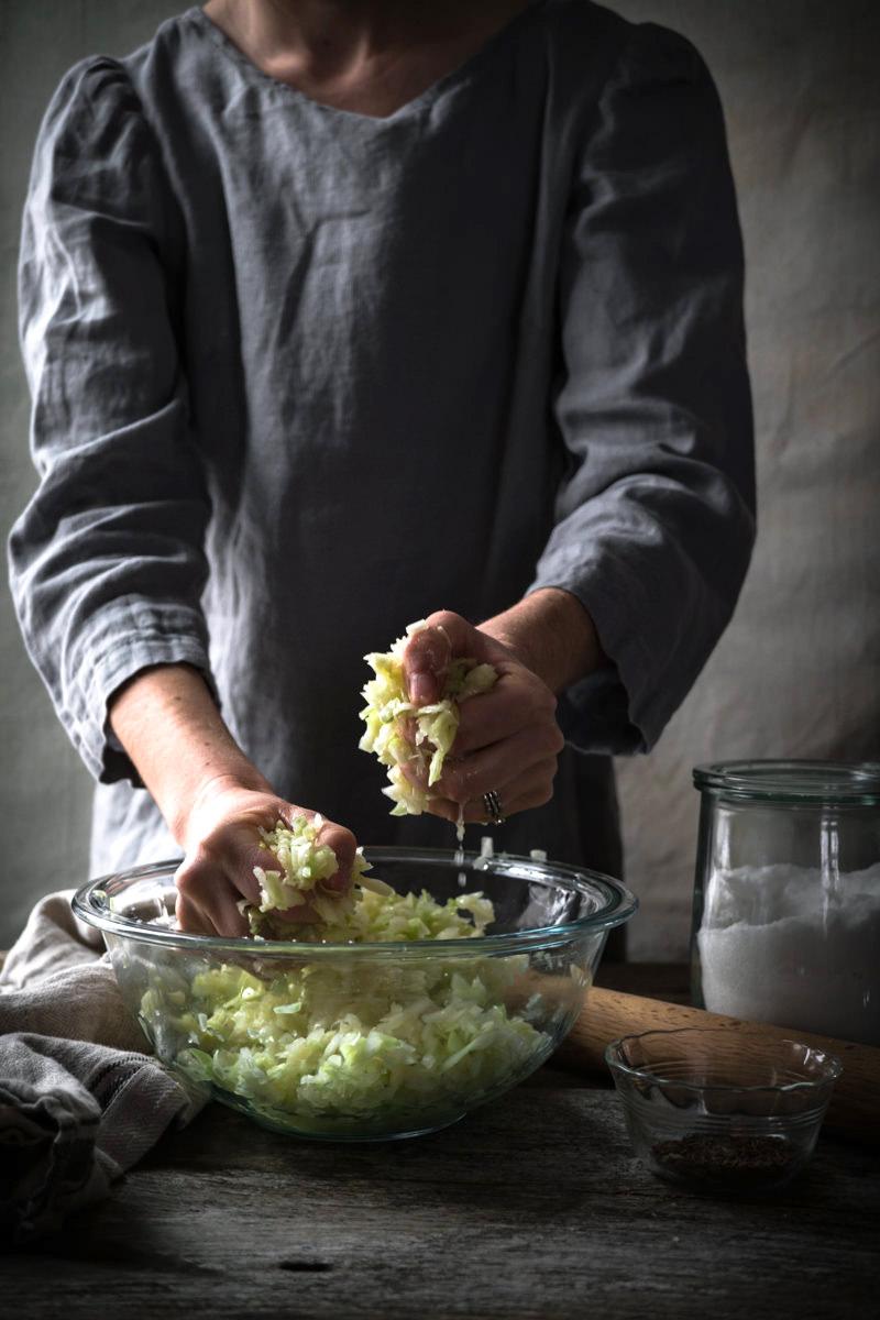 Massaging Homemade Sauerkraut by Hand