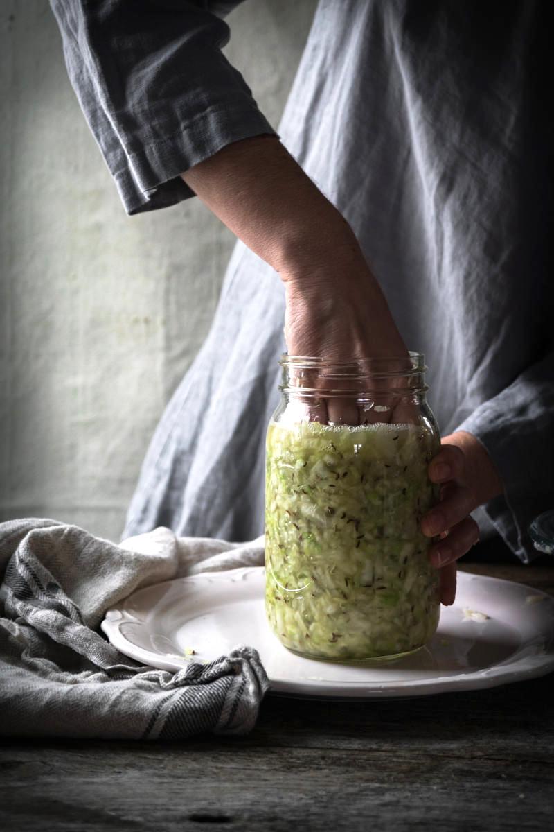 Pressing Sauerkraut into Jar