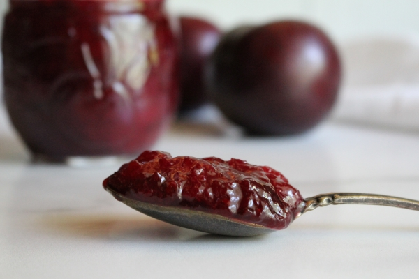 Thick spoonful of plum jam, made without added pectin