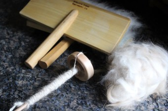 Spinning angora on a drop spindle