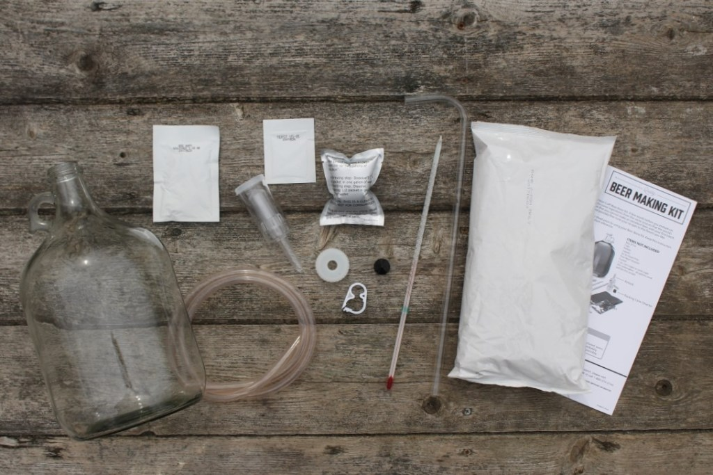 The contents of a one-gallon beer making kit contains everything you need to make a simple homemade beer.