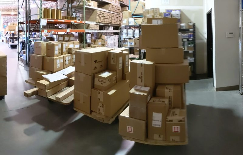 Packages on carts ready to be picked up for shipping.