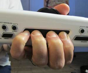 Fingers placed naturally on the Ribbon Controller