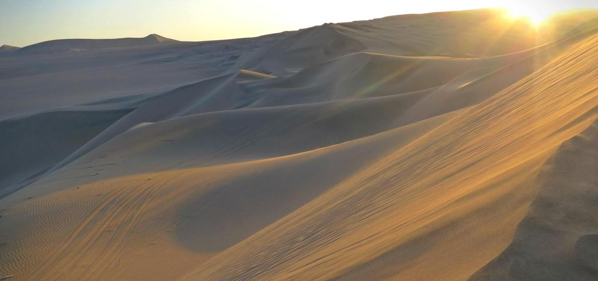 Sunset on the dunes in Huacachina, Peru.