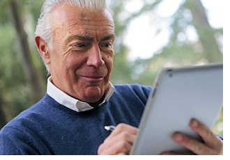 man reading newsletter on tablet