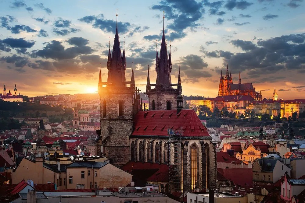 Tynsky temple and St Vitus cathedral at sunrise in Prague