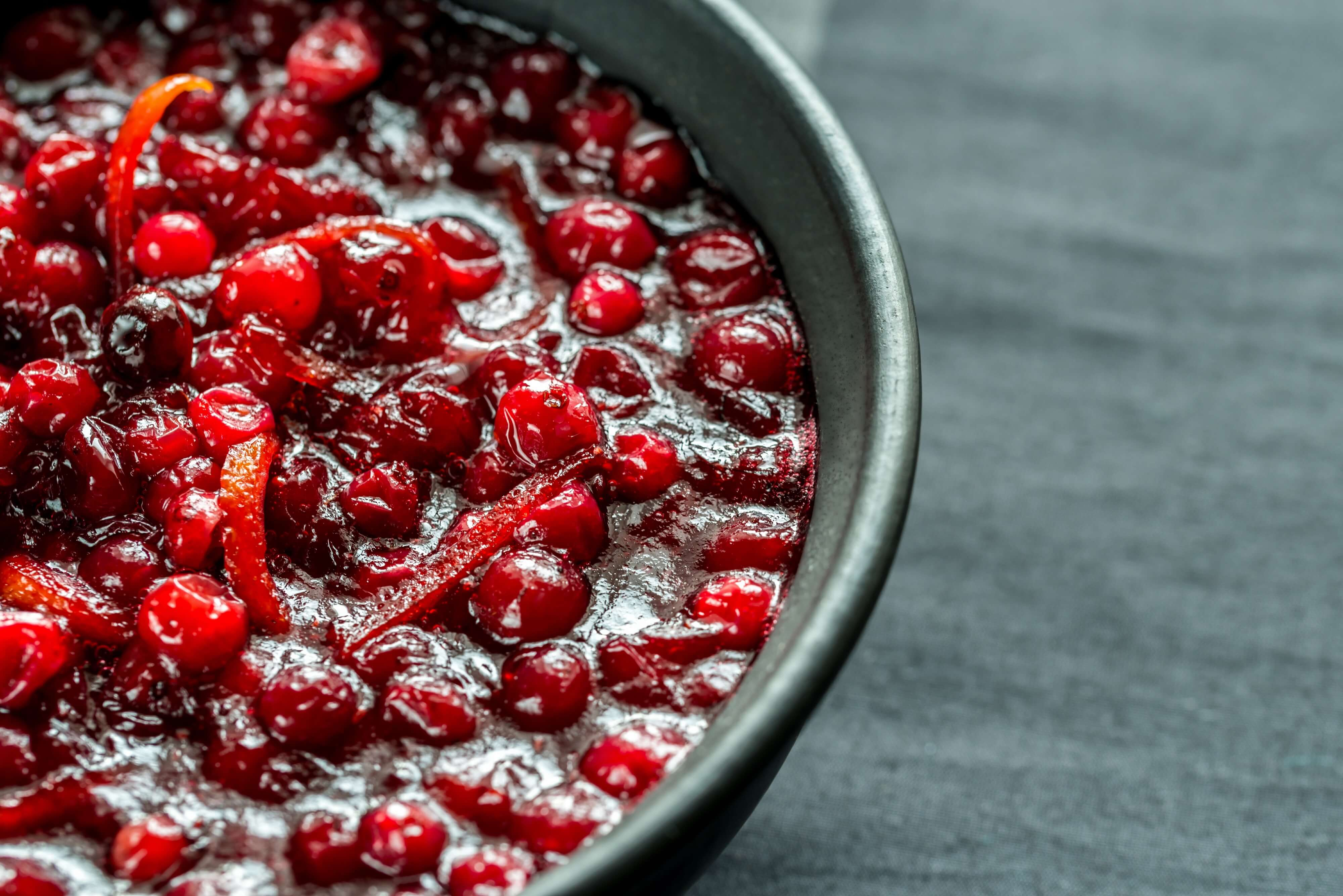 A bowl of Cranberry Chutney placed on a dinner table.