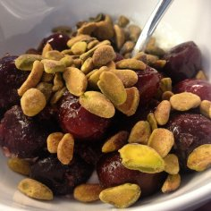 Cherries and pistachios over cottage cheese