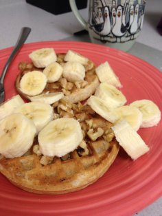 Wheat-free waffle with banana slices and walnuts