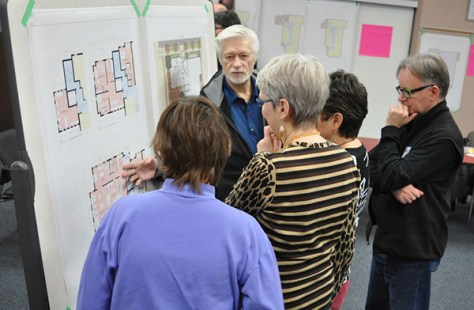Prairie Spruce members and potential members in a community design meeting with an architect.