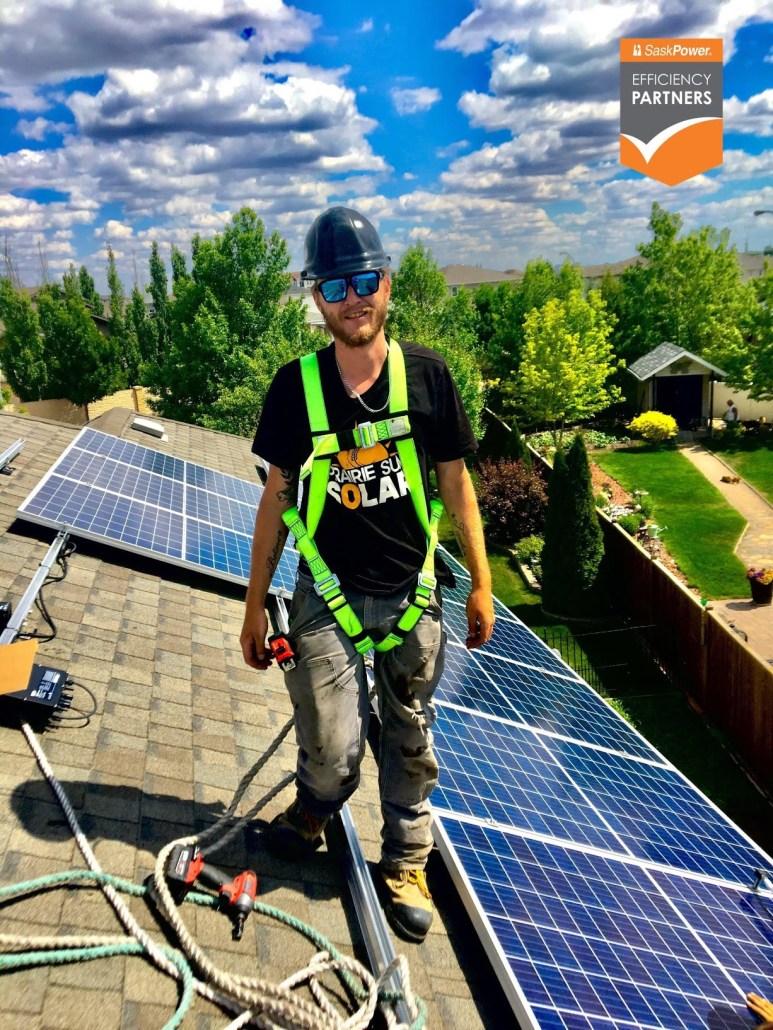 journeyman electrician justin installing solar panels