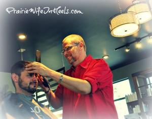 David Cutting a man's hair