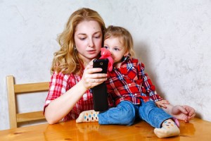 mom with kid on phone