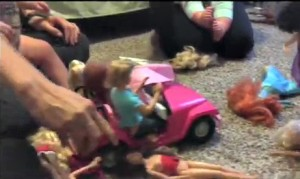playing with barbies