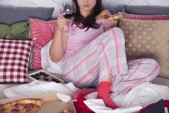 woman eating on couch