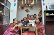 Proma in her birthday, with her mother, aunts and house-maids