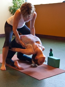 Assist in the transition into wheel at Thrive Yoga