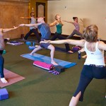 Photo: yoga class in Warrior I pose