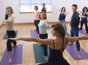 Photo: yoga class in Wwarrior II pose