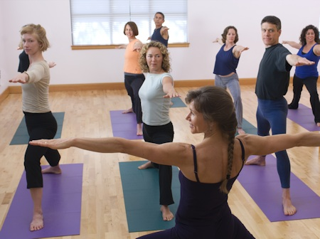 Photo: yoga class in Warrior II pose