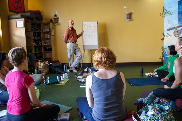 Photo: teacher in front on yoga students on floor