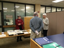 Anne Turkos, UMD Archivist talks with Dean Steele and a guest by the Gordon W. Prange Papers.