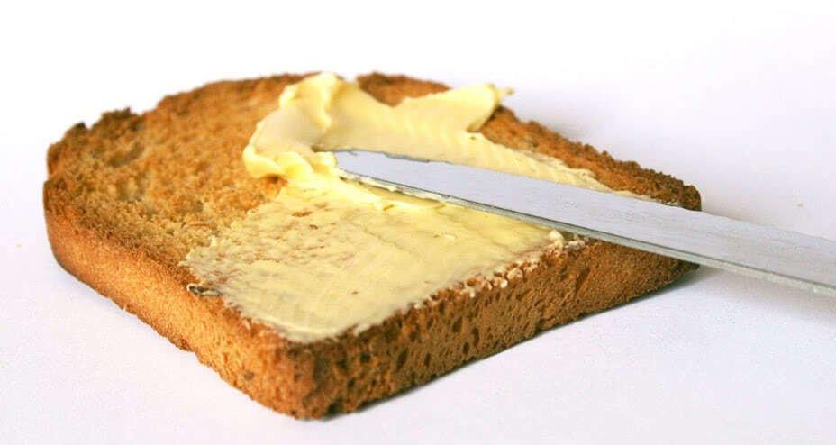 Иллюстрация масла с хлебом