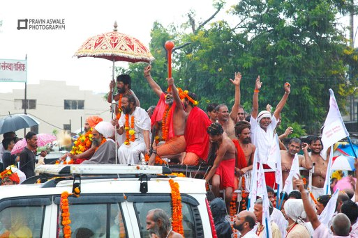 SADHUS ON TOP OF VEHICAL