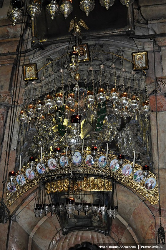 The Church of the Lord's Sepulcher. Icons and lampadas over the entrance to the Tomb.