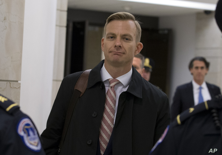 David Holmes, a career diplomat and the political counselor at the U.S. Embassy in Ukaine leaves the Capitol Hill, Friday, Nov…
