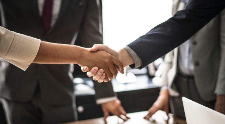praxis school of entrepreneurship hand shake