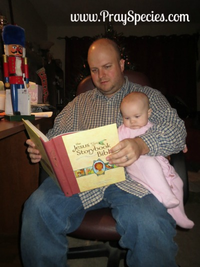 ladybug reading the storybook bible with daddy