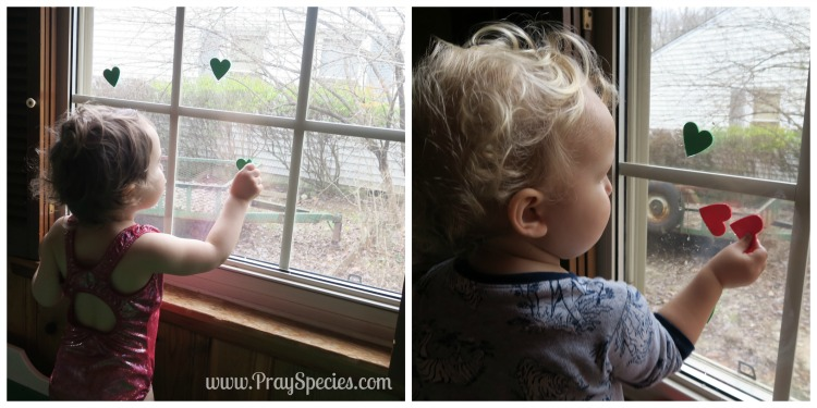 Putting Foam Hearts on the Window Collage
