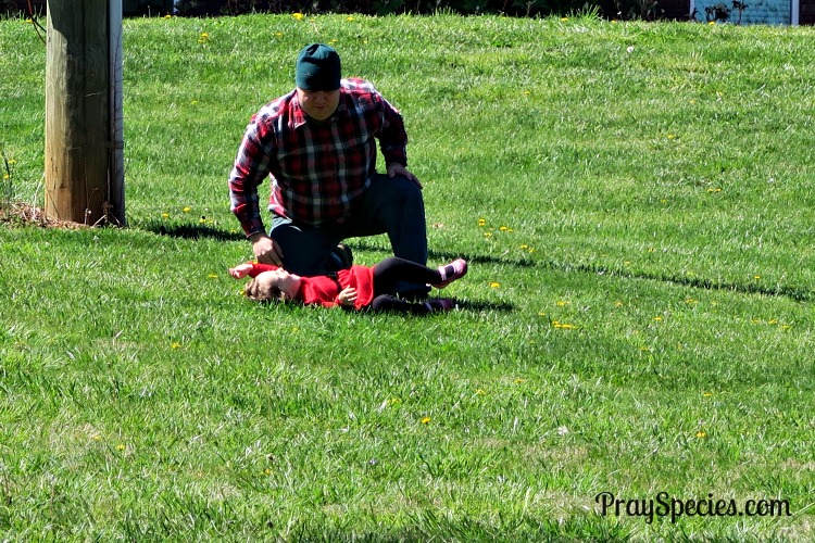 Daddy teaching Ladybug to roll down the hill