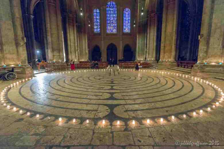 Lighting candles around the outside of the labyrinth by Jill K H Geoffrion
