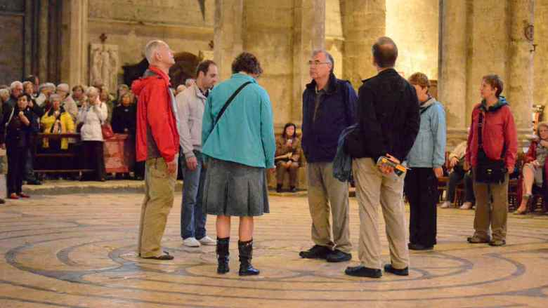 Walkers in the center of the labyrinth during a Friday open walk by Jill K H Geoffrion