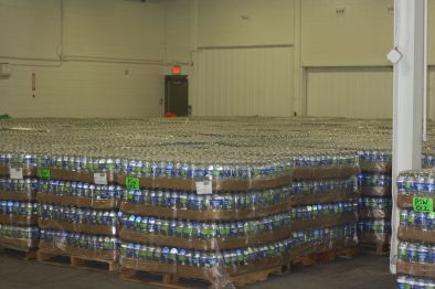 Some of the many bottled water donations in the distribution warehouse in Flint