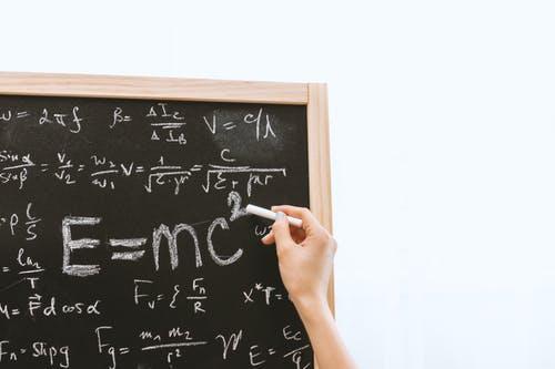 Writing equations on a blackboard