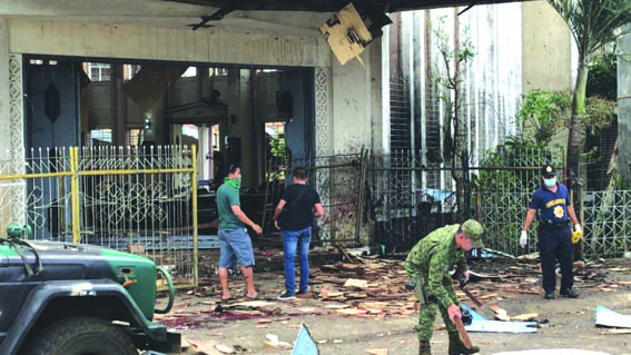 27 dead, 77 injured as twin explosions hit cathedral in Philippines