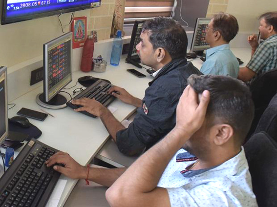 Sensex tanks 383 pts, Nifty holds 11700 in volatile trade