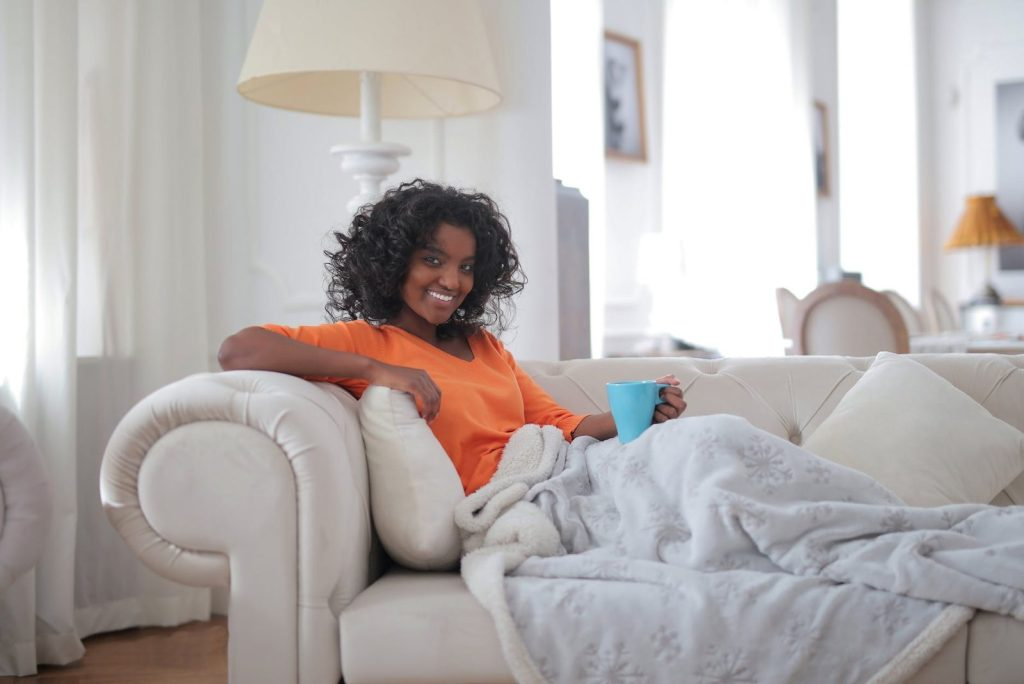 image of black woman relaxing on sofa