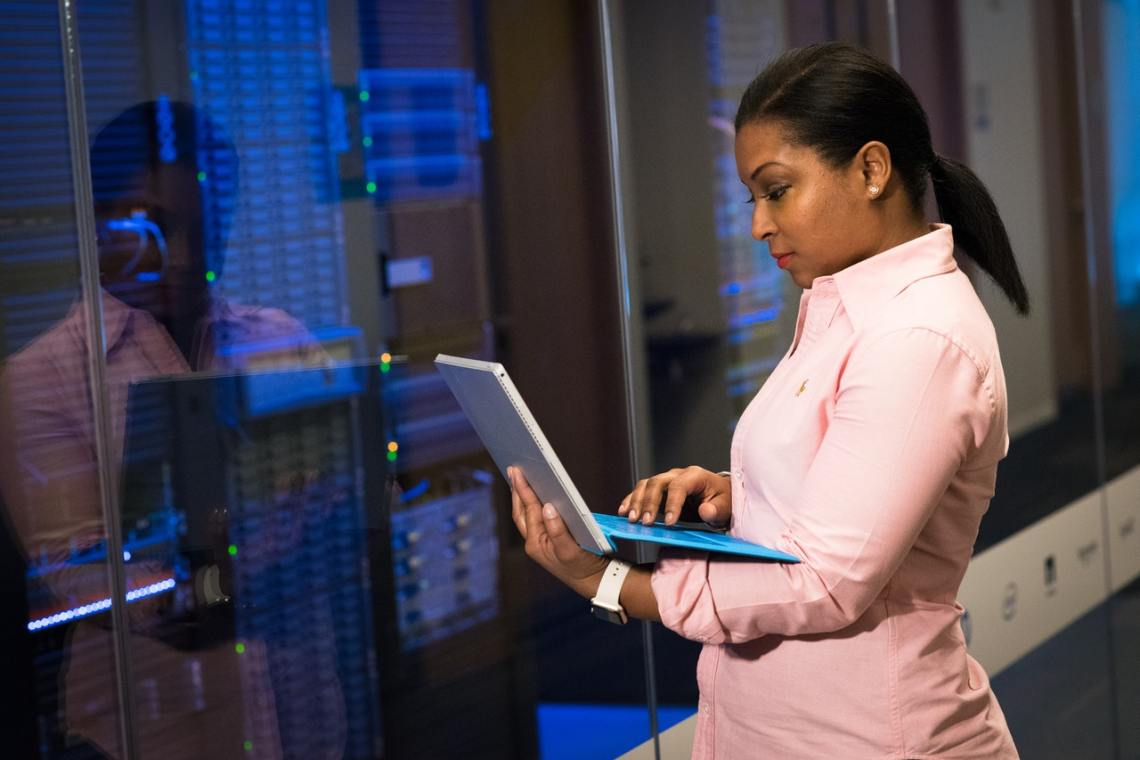 image of black woman in front of systems