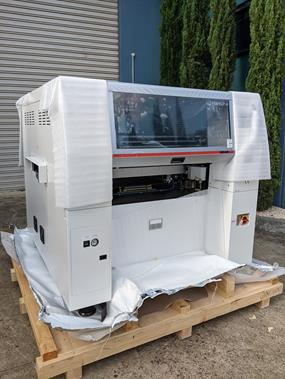 A new SMT machines on a crate