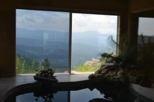 Window tinting a house in Evergreen Colorao with a beautiful view of the mountains.