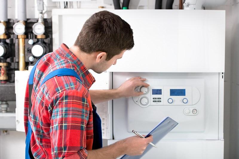 hvac technician adjusting heat pump