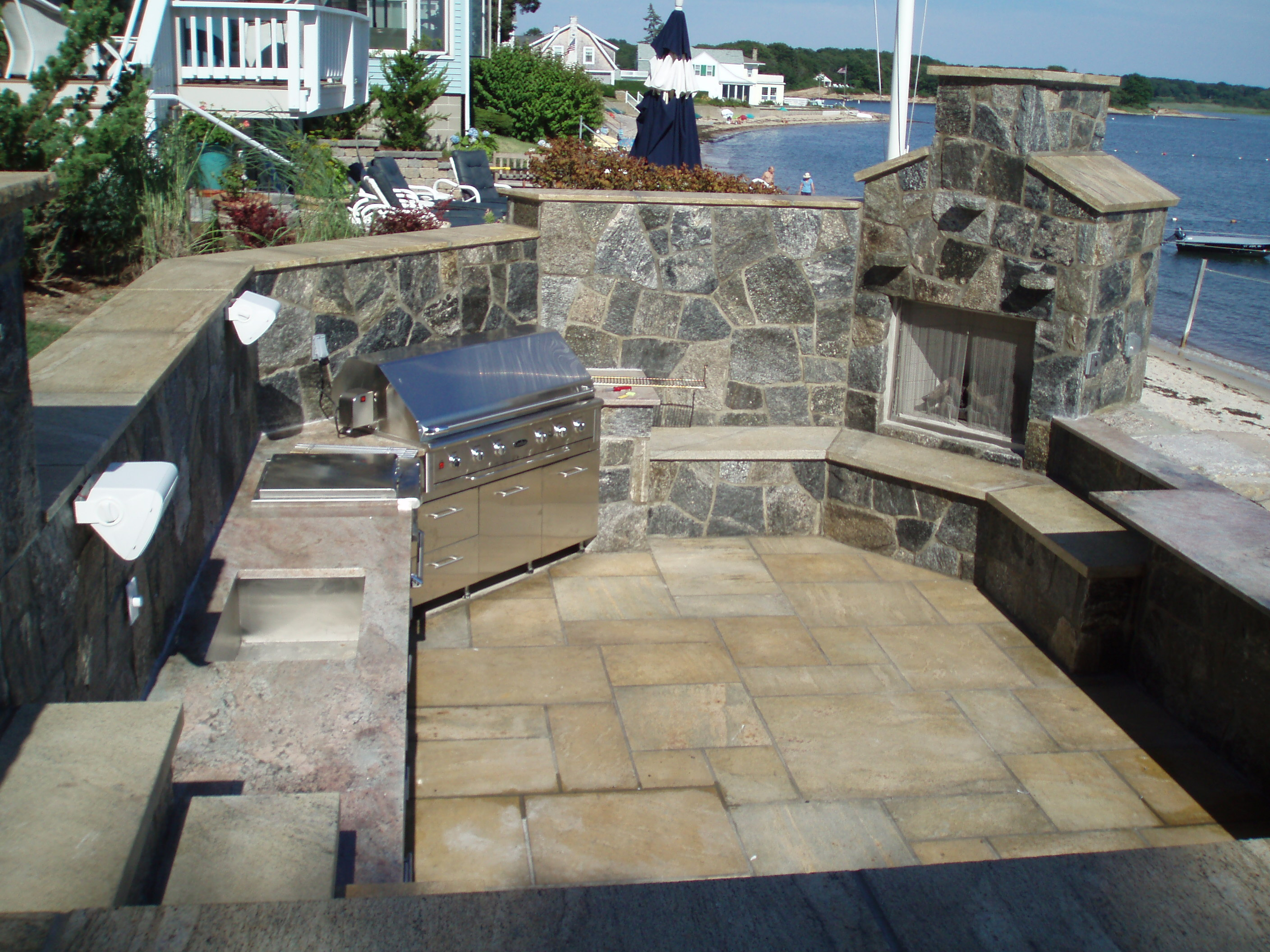 Fabulous outdoor kitchen and stone fireplace built by Preferred Properties Landscaping