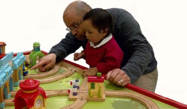 dad-and-daughter-playing-with-train