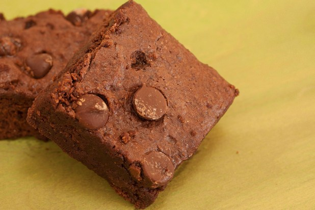 homemade chocolate brownies on yellow background
