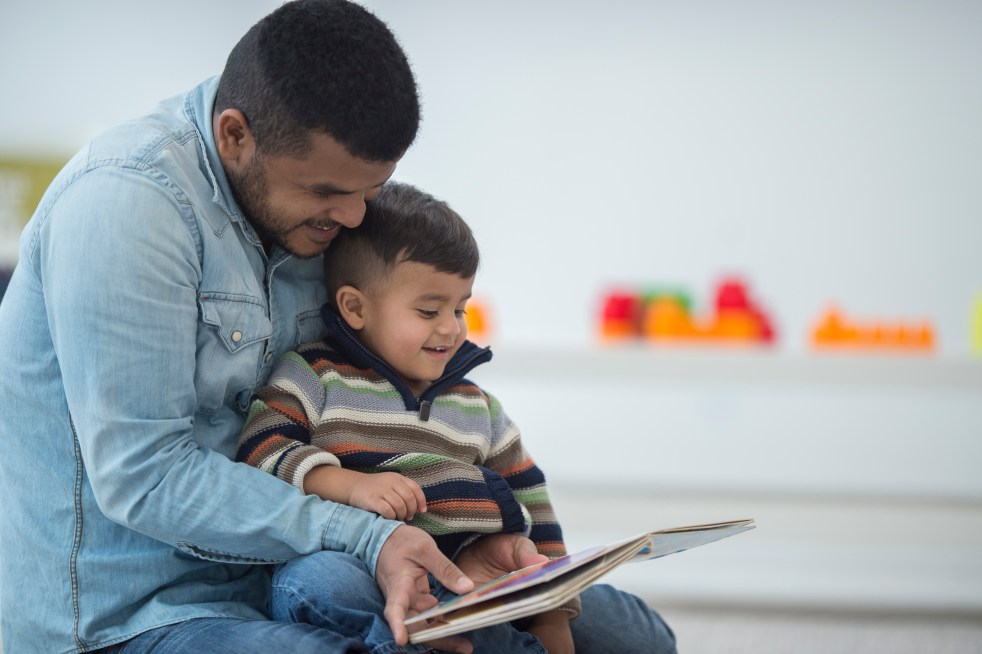 Parent reading to toddler