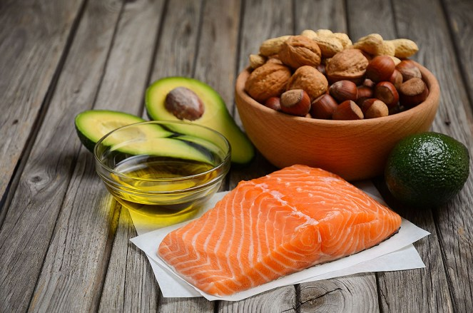 Selection of healthy fats, such as, avocado, olive oil, salmon, nuts